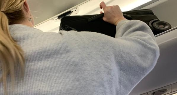 avoid injury when using overhead bins