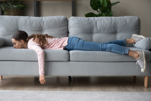 girl exhausted by long Covid