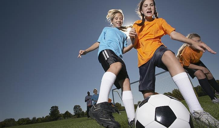 Girls playing soccer game